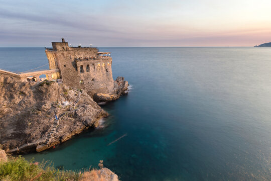 The beautiful Maiori tower along the Amalfitan coastline near Amalfi and Positano. The medieval tower is now a luxury restaurant for wedding planning. Dramatic sunset over the Mediterranean sea