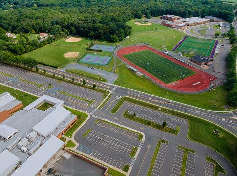During the quarantine coronavirus, school closed of empty stadium with basketball field and training ground in park