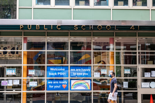 A pedestrian walks past Public School 41 following the outbreak of the coronavirus disease (COVID-19) in the Manhattan borough of New York City