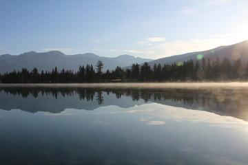 Fototapeta Reflections - Lake Beauvert, Jasper National Park, Alberta, Canada.