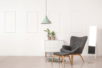 Wall Mural - Stylish armchair and ottoman with chest of drawers and mirror in room