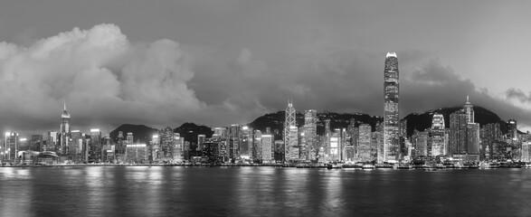 Fototapete - Panorama of Victoria harbor of Hong Kong city at night