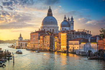 Venice grand canal, Santa Maria della Salute church landmark at sunrise. Italy