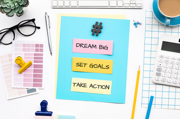 Dream big,set goals,take action concepts with text on desk table.