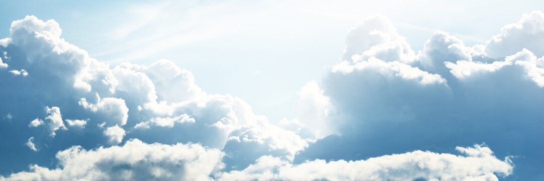 Clear blue sky with glowing white cumulus clouds after thunderstorm. Dramatic cloudscape. Concept art, meteorology, ecology, climate change, heaven, hope, peace, graphic resources. Panoramic view