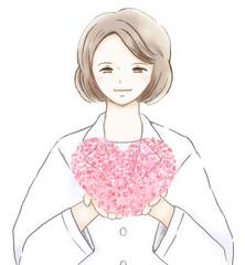花びらで作ったピンクのハートを持った白衣を着た女医