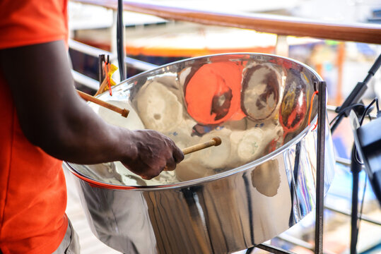 man is playing on a steel drums at cruise ship open deck