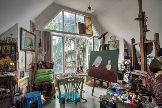 Batumi, Georgia, May 26, 2020: Interior of a artist's studio with large light window