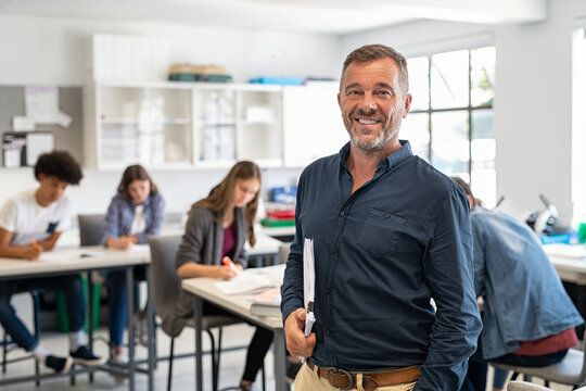 Mature man professor standing in class
