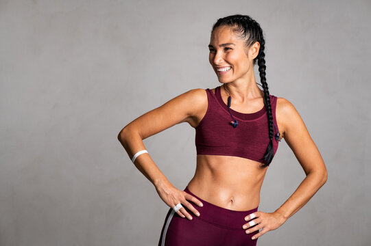 Mid smiling woman smiling after fitness training