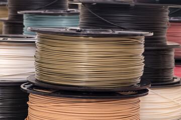 Fototapeta Spool of bronze color PLA plastic filament for 3D printer. obraz
