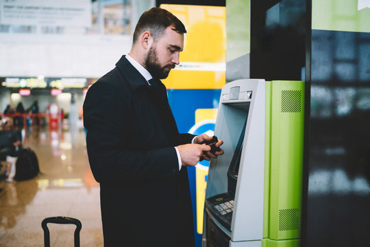 Businessman checking account balance for withdraw cash at ATM and make airport ticketing,proud CEO with wallet reading displayed security answer about commission for getting international money
