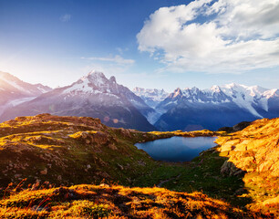 Wall Mural - Mighty Mont Blanc glacier with lake Lac Blanc. Location Chamonix resort, Graian Alps, France, Europe.