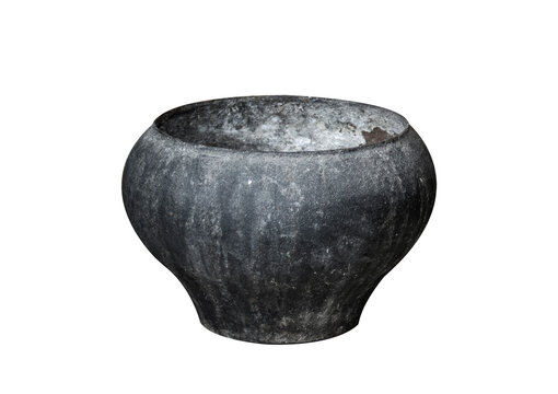 Cast iron black old cooking pot isolated on white background. Medieval tableware.