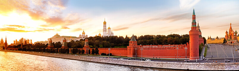 moscow kremlin landmark skyline panorama at sunset. Ultra wide panoramic view from moscow river embankment against moscow city skyscrapers on background. Historic moscow city landscape