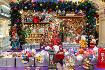 MOSCOW, RUSSIA - December 18, 2019. GUM Main Department Store. New Year and Christmas fair. Sellers in national costumes. Presents for tourists.