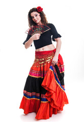Beautiful young female flamenco dancer in traditional vivid Spanish dress in various poses