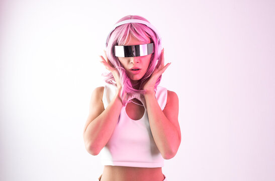 Young woman with pink hair dancing and having fun