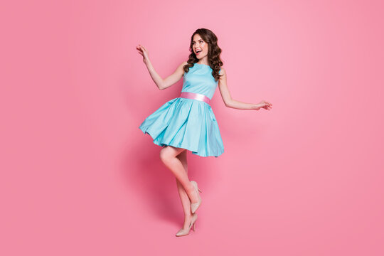 Full length profile photo of wavy charming lady festive event prom party dancing good mood night club chill short skirt wear blue mini dress stilettos isolated pink color background