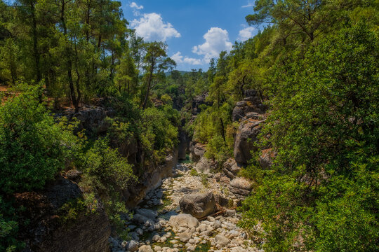 Creek eroded rocks. Flowing stream between rocks. Antalya Koprulu Canyon. Turkey, august 2020