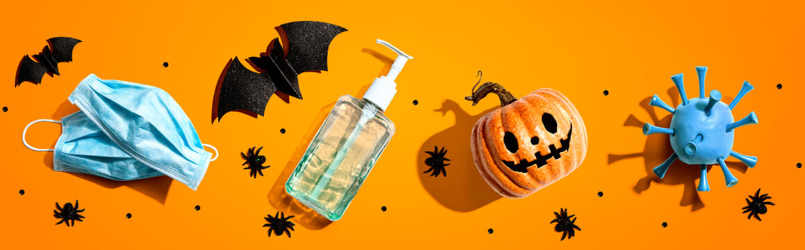 Masks and sanitizer bottle with Halloween objects - healthcare and hygiene concept