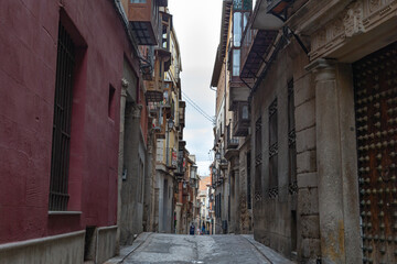 Narrow and old streets with stone and mud buildings in the city of Toledo