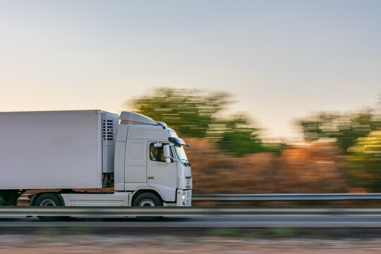 Refrigerator truck driving fast on the highway