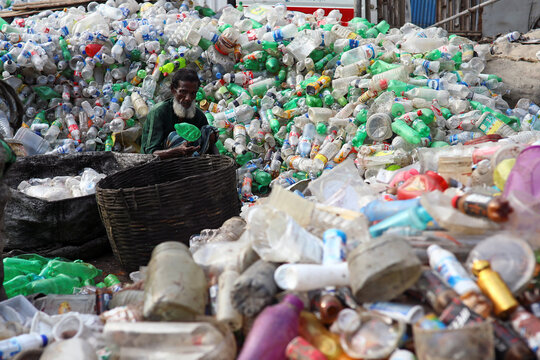 Man works in a plastic bottle recycling factory amid the coronavirus disease (COVID-19) outbreak in Dhaka