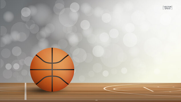 Basketball ball on basketball court area with light blurred bokeh background. Abstract background for basketball sport with light effect. Vector.