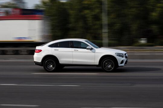 Ukraine, Kyiv - 24 September 2020: White BMW X6 car moving on the street