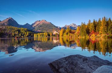 Panorama of High Tatras mountains - National park and Strbske pleso  (Strbske lake) mountain lake in Slovakia