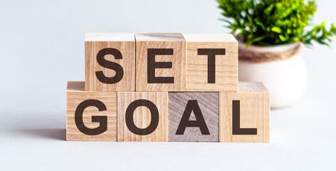 Set Goal Motivational Text on a wooden background