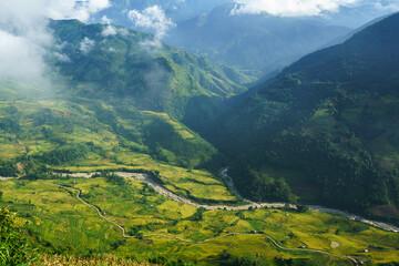 Photo sur Plexiglas Bleu jean Terraced rice field landscape with low clouds in Y Ty, Bat Xat district, Lao Cai, north Vietnam