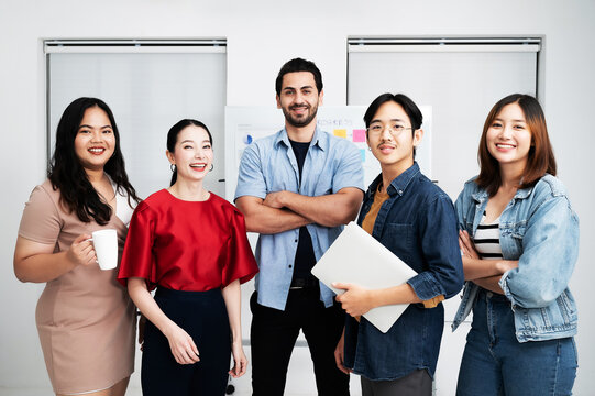 Portrait of business teamwork standing together feeling happy and smile. Multiethnic diverse people team entrepreneur startup