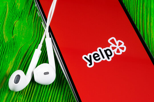 Helsinki, Finland, May 4, 2019: Yelp application icon on Apple iPhone X screen close-up. Yelp app icon. Yelp.com application. Social network. Social media