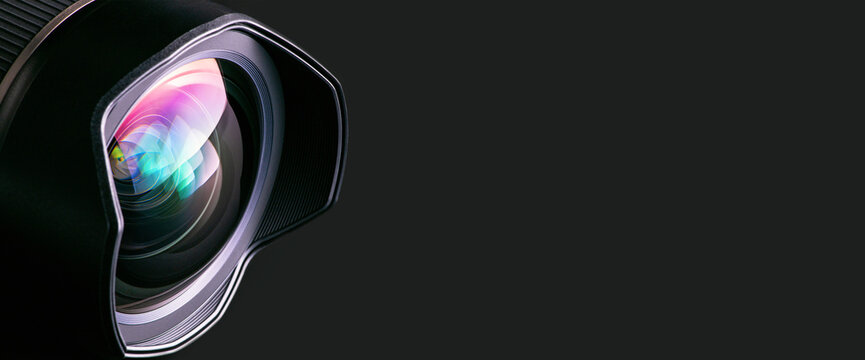 .Camera lens on a black background. Wide-angle close-up lens. Macro. Banner.
