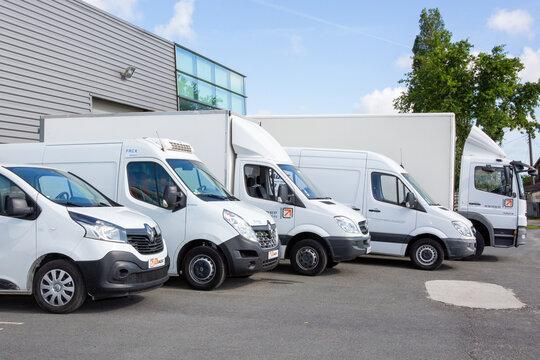 transport dumont  several cars vans trucks parked in parking lot for rent or delivery