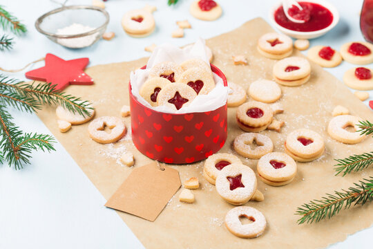 Traditional Austrian christmas cookies - Linzer biscuits filled with raspberry jam.