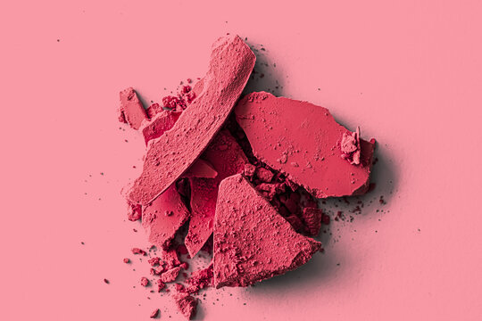 Red eye shadow powder as makeup palette closeup, crushed cosmetics and beauty textures