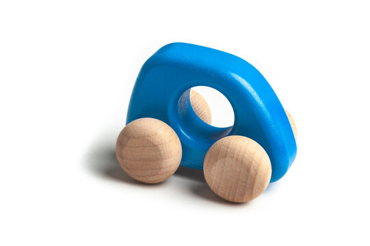Small blue wooden toy car on white background