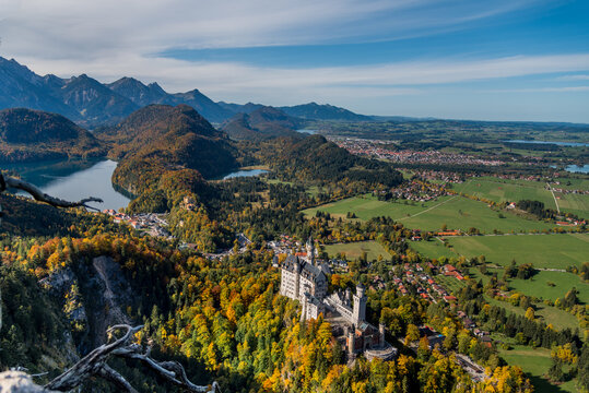 View of the world famous Neuschwanstein castle in autumn/fall from the vantage point on Tegelberg