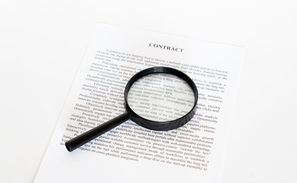 Magnifying Glass and document close up. Business concept