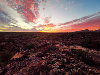 African Sunrise / Sunset over Rocky Meadow in the Rocklands, Cederberg, South Africa, Colourful Sky, colorful clouds, horizon panorama.  Wall mural