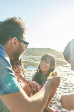 Happy family son sunny beach