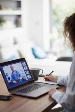 Woman video conferencing with doctor on laptop screen