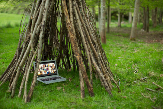 Video conference on laptop screen in branch teepee