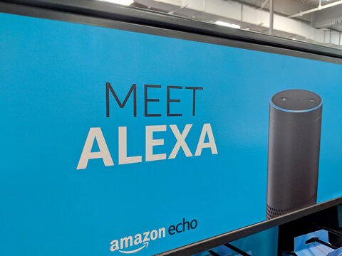 Meet Alexa Amazon Echo sign which is a Smart Assistant on a blue wall display