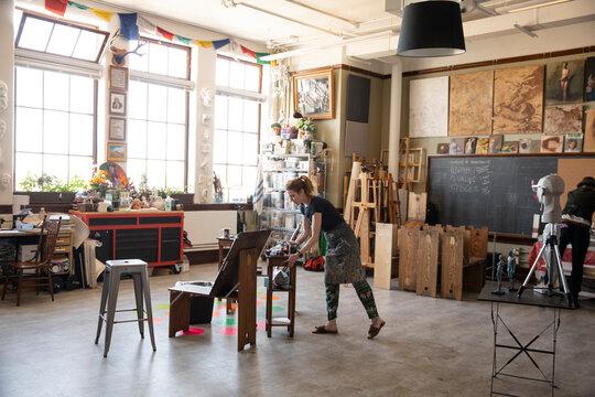 Female artist working in creative art studio