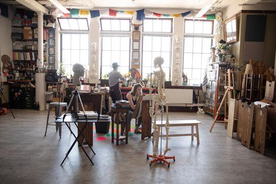 Artists working in creative art studio