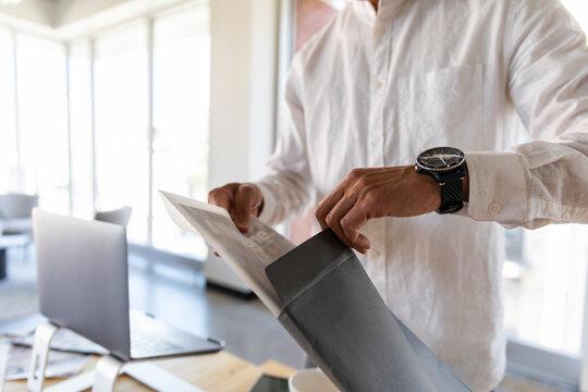 Man preparing paperwork in business coworking space